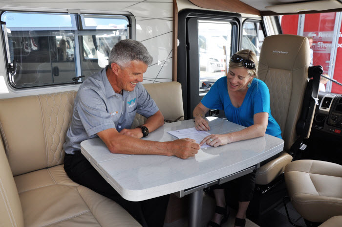 SmartRV staff with a customer inside a motorhome